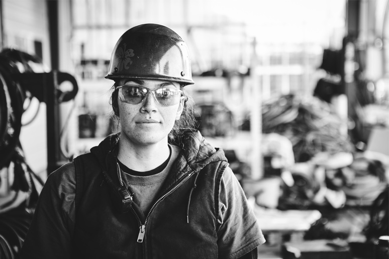 Woman at a construction site with a hardhat